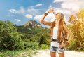 Hiking girl is drinking water Royalty Free Stock Photo