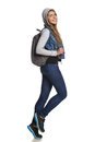 Hiking girl hiker backpack full length walking studio Royalty Free Stock Photography