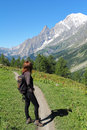 Hiking girl looks at the mont blanc on mountain trail mountain and outdoor conceptual Royalty Free Stock Photography