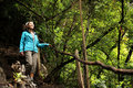 Hiking girl walking in autumn rain forest Royalty Free Stock Image
