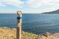 Hiking guidepost wooden against the background of the coast Stock Photos