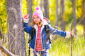 Hiking kid girl with backpack in autum poplar forest trees and walking stick Stock Image
