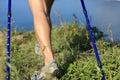 Hiking legs walking on seaside mountain peak Royalty Free Stock Photo