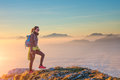 Hiking on mountain ridge in the sea of clouds Royalty Free Stock Photo