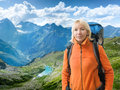 Hiking in mountains woman with backpack Stock Photo