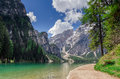 Hiking path along the pearl of the dolomites the pragser wildse wildsee or lake braies with mount seekofel in background Stock Image