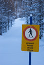 Hiking path closed sign indicating that a winter is most likely due to high snow fall Stock Photo