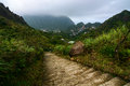 Hiking path leading into the mountains from jiufen taiwan with mount keelung shrouded in clouds in the background old cracked Royalty Free Stock Photography