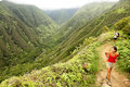 Hiking people on hawaii waihee ridge trail maui usa young women and men hikers walking in beautiful lush hawaiian forest nature Royalty Free Stock Photography