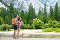 Hiking people on hike in nature in yosemite mountains hikers young couple pointing looking up mountain landscape national Stock Photo