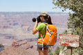 Hiking photographer taking pictures grand canyon in at hike by south rim by bright angle trail young woman hiker enjoying nature Stock Photos