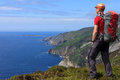 Hiking the slieve league hiker looking at at beautiful atlantic coast in donegal ireland Stock Photo