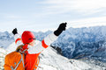 Hiking success, woman in winter mountains Stock Photo