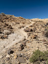 Hiking trail in a volcanic ground mountain Stock Image