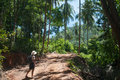 Hiking through tropical forest in thailand the woman hikes a the ko samui palms and blue sky are the background Royalty Free Stock Images