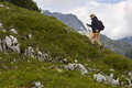 Hiking uphill mature woman in the alps Royalty Free Stock Images
