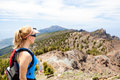 Hiking woman runner in summer mountains female hiker looking at beautiful view fitness and healthy lifestyle outdoors nature Stock Photos
