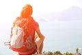 Hiking woman sit seaside rock Royalty Free Stock Photo