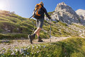 Hiking young woman on a sunny day in high mountains Royalty Free Stock Image