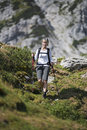 Hiking young woman on a sunny day in high mountains Royalty Free Stock Photos