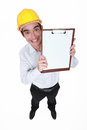 Hilarious craftsman holding clipboard up a Stock Photos