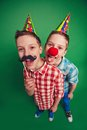 Hilarious twins with clown nose and moustache during fool�s day celebration Royalty Free Stock Photos