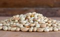 Hill of beans on the wooden table Royalty Free Stock Photos