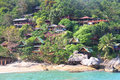 Hill with bungalows on tropical beach beautiful Royalty Free Stock Image