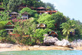 Hill with bungalows on tropical beach green Stock Photography