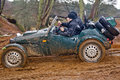 Hill climb in mud great brickhill uk february unnamed members of the falcon cc take there specially designed climbing car through Royalty Free Stock Images