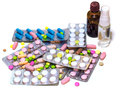 Hill of colorful pills and medicaments for all ills isolated on white Royalty Free Stock Photo