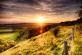 Hill fence sunset landscape with evening Royalty Free Stock Photos