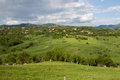 Hill landscape a little village named dambovicioara in a in romania Royalty Free Stock Photo