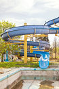 A hill is in water park dry pool and steep are unworking aquapark Stock Photos