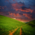 Hills and road to red clouds Royalty Free Stock Photography