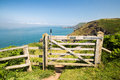 Hills in southwest wales looking through a gate at the sea near mint with mist covering peaks with and gates on coastal path Stock Photos