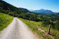 Hillside road and mountains in haute savoie france Stock Photo