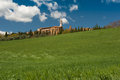 Hilltop town tuscany ws a traditional pienza italy surrounding green fields and iconic tuscan cypress trees Stock Images