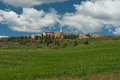 Hilltop town tuscany xws a traditional pienza italy surrounding green fields and iconic tuscan cypress trees Stock Photo