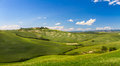 Hilly landscape with blue skies in Crete Senesi, Asciano, Siena, Italy Royalty Free Stock Photos