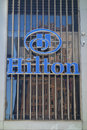 Hilton hotel and resorts logo a of the hotels on a on sixth avenue in midtown manhattan Royalty Free Stock Images