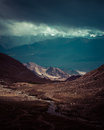 Himalaya high mountain landscape india ladakh panorama with dramatic cloudy sky vintage style processing image Royalty Free Stock Image