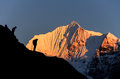 Himalaya sunset nepal the climber on the ridge of range Royalty Free Stock Photography
