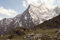 Himalayan rock home surrounded by great mountains Stock Image