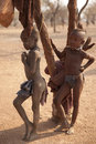 Himba children running in the village namibia Royalty Free Stock Photos