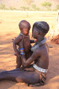 Himba girl with a children namibia epupa may portrait of an unidentified young the are indigenous peoples living in northern Stock Image