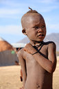 Himba kid unidentified village in namibia stand in his village the are indigenous peoples of about to people living in Stock Images