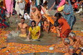 Hindu devotees come to confluence of the Ganges River for holy dip during the festival Kumbh Mela Royalty Free Stock Photo