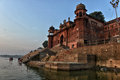 Hindu ghats in varanasi dawn view of niranjani ghat on the ganges river Stock Photo