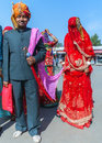Hindu groom and bride in deshnoke india circa february brings his veiled trophy wife home on a leash Stock Photos